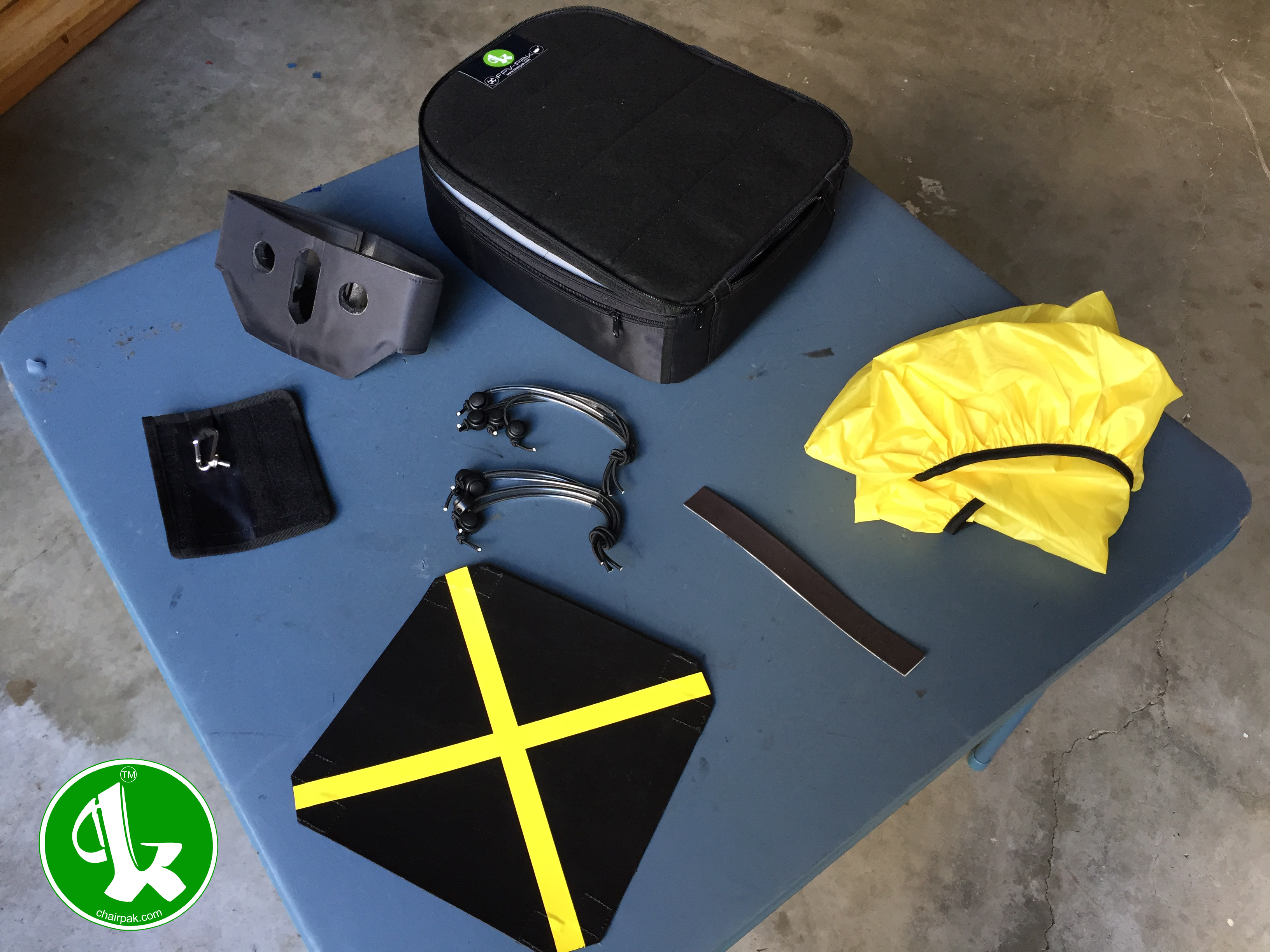 FPV Pak to include: FPV Pak insert, protective radio mask, work table/launch pad, magnet strip, two external bungee attachment systems, waterproof backpack cover Chair-Pak FPV Pak Includes waterproof cover, protective radio mask. magnet strip, worktable/launch pad, external attach bungee system